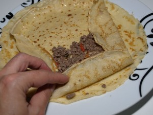 crêpes with meat in creamy chanterelle sauce